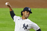 New York Yankees pitcher Deivi Garcia winds up  during the first inning of the team's baseball game against the Toronto Blue Jays on Tuesday, Sept. 15, 2020, in New York. (AP Photo/Adam Hunger)
