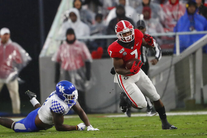 Georgia running back D'Andre Swift (7) breaks away from a Kentucky defender during the first half of an NCAA college football game Saturday, Oct. 19, 2019, in Athens, Ga. (AP Photo/John Bazemore)