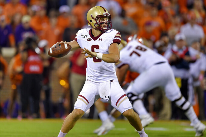 Boston College quarterback Dennis Grosel drops back to pass during the first half of an NCAA college football game against Clemson, Saturday, Oct. 26, 2019, in Clemson, S.C. (AP Photo/Richard Shiro)