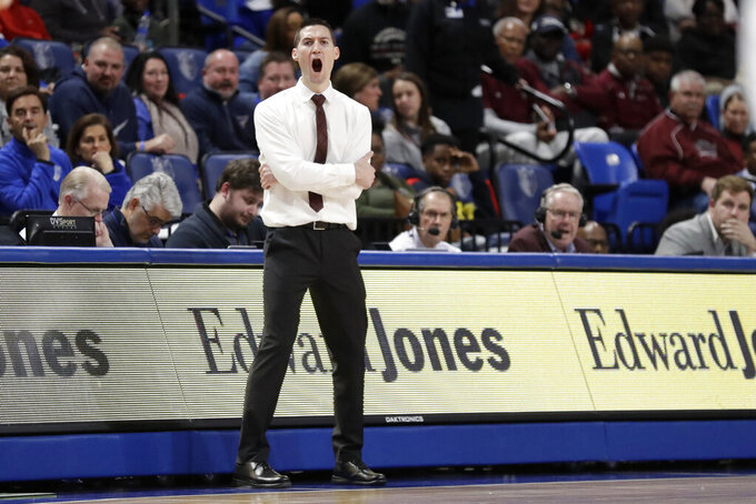 Southern Illinois head coach Bryan Mullins yells from the sideline during the second half of an NCAA college basketball game against Saint Louis, Sunday, Dec. 1, 2019, in St. Louis. (AP Photo/Jeff Roberson)