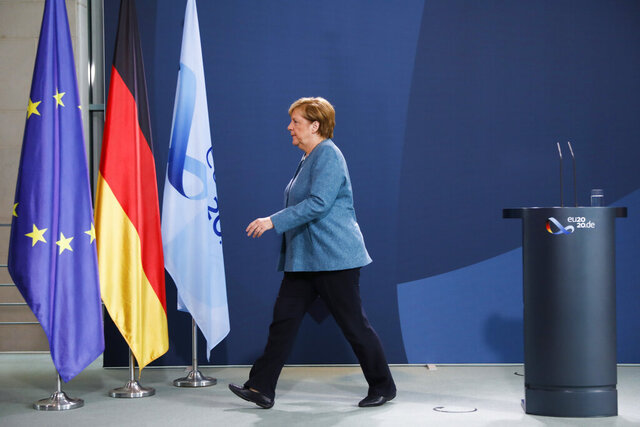 German Chancellor Angela Merkel leaves after a statement about latest developments in the case of Russian opposition leader Alexei Navalny at the chancellery in Berlin, Germany, Wednesday, Sept. 2, 2020.Germany. Russian opposition leader Alexei Navalny was the victim of an attack and poisoned with the Soviet-era nerve agent Novichok, the German government said Wednesday, Sept. 2, 2020 citing new test results. (AP Photo/Markus Schreiber, Pool)