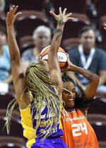 Los Angeles Sparks guard Arella Guirantes pressures Connecticut Sun forward DeWanna Bonner during a WNBA basketball game Thursday, Aug. 26, 2021, in Uncasville, Conn. (Sean D. Elliot/The Day via AP)