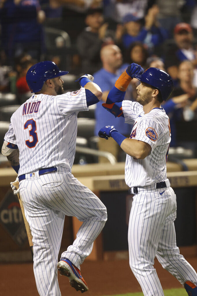 New York Mets' Jeff McNeil, right, celebrates with teammate Tomas Nido after hitting a home run during the seventh inning of a baseball game against the Philadelphia Phillies, Sunday, Sept. 19, 2021, in New York. (AP Photo/Jason DeCrow)