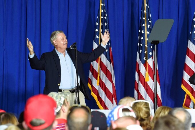 U.S. Sen. Lindsey Graham of South Carolina speaks ahead of an appearance by Vice President Mike Pence at a campaign rally on Tuesday, Oct. 27, 2020, in Greenville, S.C. (AP Photo/Meg Kinnard)