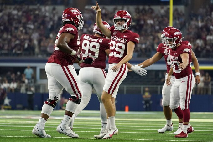Arkansas place kicker Cam Little (29) celebrates his field goal in the second half of an NCAA college football game against Texas A&M in Arlington, Texas, Saturday, Sept. 25, 2021. (AP Photo/Tony Gutierrez)