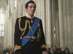 """This image released by Netflix shows Josh O'Connor as Prince Charles in a scene from """"The Crown."""" O'Connor is nominated for an Emmy Award for outstanding leading actor in a drama series. (Alex Bailey/Netflix via AP)"""