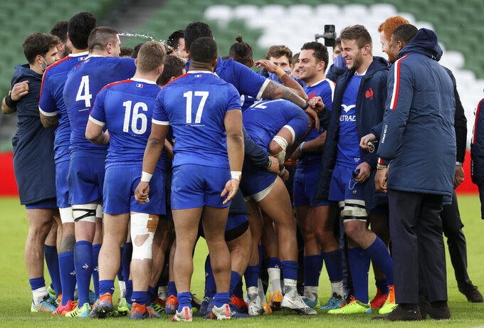 French players celebrate at the end of the Six Nations rugby union match between Ireland and France Aviva Stadium, Dublin, Sunday, Feb. 14, 2021. France won the match 15-13. (Brian Lawless, Pool via AP)