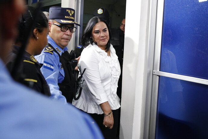 Former Honduran first lady Rosa Elena Bonilla de Lobo leaves court after her conviction on corruption charges in Tegucigalpa, Honduras, Tuesday, Aug. 20, 2019. The court convicted the former first lady on Tuesday of embezzling about $600,000 in government money between 2010 and 2014, when her husband Porfirio Lobo was president. Bonilla's sentence will be announced Aug. 28 and could run between 58 and 87 years in prison. (AP Photo/Elmer Martinez)