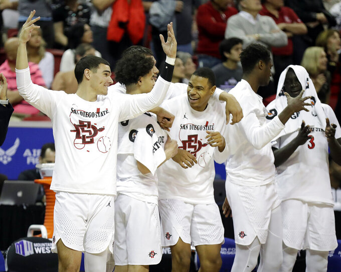 The San Diego State bench reacts during the second half of the team's NCAA college basketball game against Boise State in the Mountain West Conference men's tournament Friday, March 6, 2020, in Las Vegas. (AP Photo/Isaac Brekken)