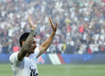 PSG's Lionel Messi waves during players presentation before the French League One soccer match between Paris Saint Germain and Strasbourg, at the Parc des Princes stadium in Paris, Saturday, Aug. 14, 2021. (AP Photo/Francois Mori)