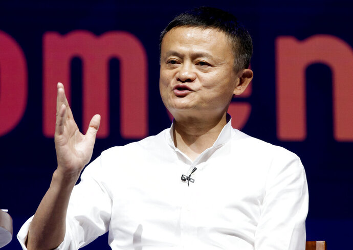 FILE - In this Oct. 12, 2018, file photo, Chairman of Alibaba Group Jack Ma speaks during a seminar in Bali, Indonesia. An annual survey of China's wealthiest businesspeople found they got richer this year despite a tariff war with Washington and slowing economic growth. The Hurun Report said the net worth of China's richest 1,800 people rose 10% over 2018 to $1.4 billion. Ma, who retired last month as chairman of e-commerce giant Alibaba, was No. 1 with a fortune of $39 billion. (AP Photo/Firdia Lisnawati, File)
