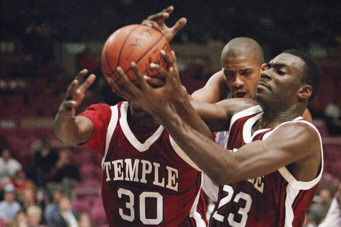 FILE - In this Dec. 29, 1993, file photo, Temple's Jason Ivey (30) and Aaron McKie (23) struggle for possession as Fairleigh Dickinson's Donald Osbourne approaches during the consolation game of the ECAC Holiday Festival Tournament in New York's Madison Square Garden. McKie is just the third head coach for Temple since Hall of Famer John Chaney was hired in 1982. (AP Photo/Mike Albans, File)