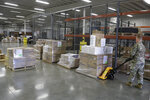 A Indiana National Guardsman linesup pallets of medical supplies to be delivered, Thursday, March 26, 2020, in Indianapolis. The medical supplies were being delivered to Indiana hospitals and health departments to help fight the coronavirus pandemic.  The new coronavirus causes mild or moderate symptoms for most people, but for some, especially older adults and people with existing health problems, it can cause more severe illness or death.(AP Photo/Darron Cummings)