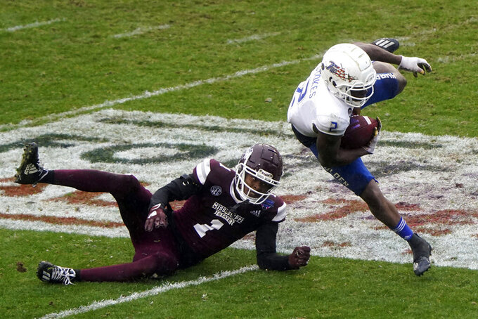 Tulsa wide receiver Keylon Stokes (2) runs the ball past Mississippi State cornerback Martin Emerson (1) during the second half of the Armed Forces Bowl NCAA college football game Thursday, Dec. 31, 2020, in Fort Worth, Texas. (AP Photo/Jim Cowsert)