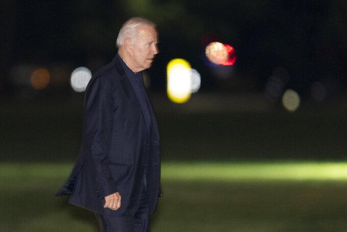 President Joe Biden walks on the Ellipse near the White House in Washington, upon arrival from a trip to Europe, late Wednesday, June 16, 2021. (AP Photo/Manuel Balce Ceneta)