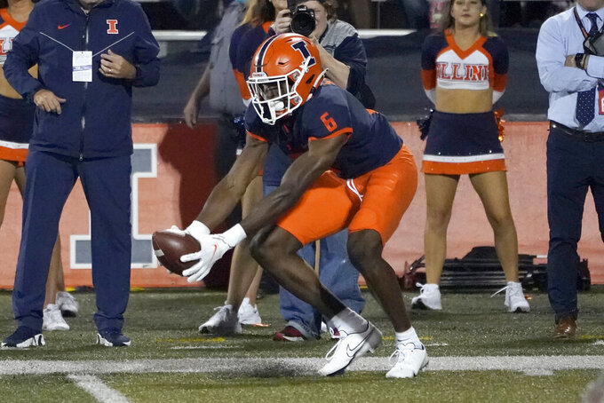 Illinois' Deuce Spann catches a pass from quarterback Artur Sitkowski for a touchdown during the first half of an NCAA college football game against UTSA, Saturday, Sept. 4, 2021, in Champaign, Ill. (AP Photo/Charles Rex Arbogast)
