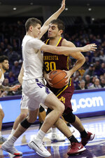 Minnesota forward Alihan Demir, right, drives against Northwestern forward Robbie Beran during the first half of an NCAA college basketball game in Evanston, Ill., Sunday, Feb. 23, 2020. (AP Photo/Nam Y. Huh)