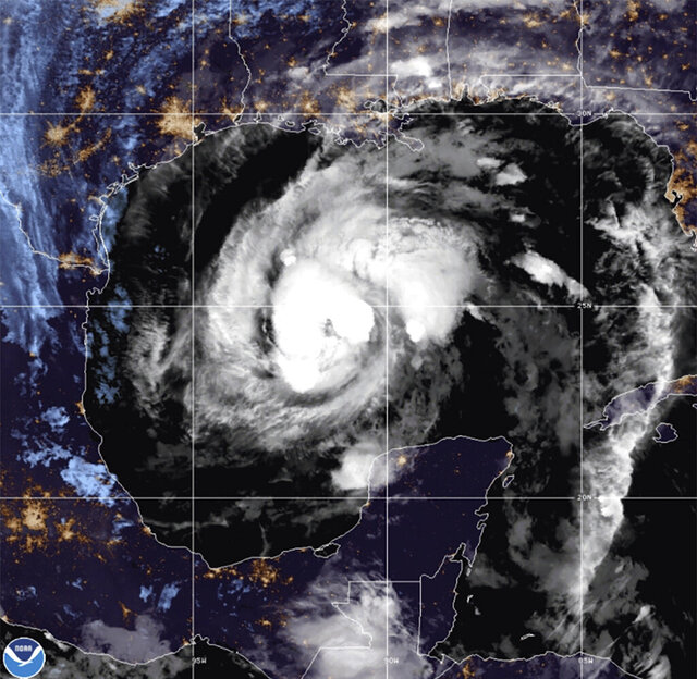 This satellite image provided by the National Oceanic and Atmospheric Administration shows Tropical Storm Zeta, Wednesday, Oct. 28, 2020, at 10:52 GMT (06:52 EDT). (NOAA/NESDIS/STAR via AP)