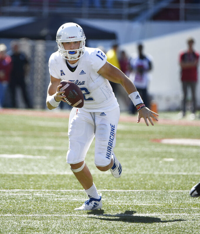 FILE - In this Oct. 20, 2018, file photo, Tulsa quarterback Seth Boomer scrambles out of the pocket against Arkansas in the second half of an NCAA college football game in Fayetteville, Ark. Tulsa faces Navy on Saturday. (AP Photo/Michael Woods, File)