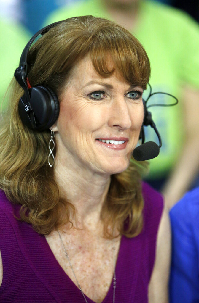 """FILE - In this March 5, 2017, file photo, Debbie Antonelli, a women's college basketball analyst for ESPN, listens before a women's NCAA college basketball game between Duke and Notre Dame in Conway, S.C. Antonelli wanted to do something to help raise money and awareness for South Carolina Special Olympics. So about a year ago she came up with the concept of '24 Hours of Nothing But Net"""". She vowed to make 2,400 free throws for 24 straight hours. She did just that over the weekend, making 2,400 of 2,553 free throws, hitting at 94% accuracy, at the Mount Pleasant Town Hall gym. (AP Photo/Mic Smith, File)"""