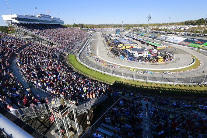 People waatch the start of the NASCAR Cup Series race at Martinsville Speedway in Martinsville, Va., Sunday, Oct. 27, 2019. (AP Photo/Steve Helber)