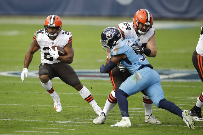 Cleveland Browns running back Nick Chubb (24) carries the ball against the Tennessee Titans in the first half of an NFL football game Sunday, Dec. 6, 2020, in Nashville, Tenn. (AP Photo/Ben Margot)