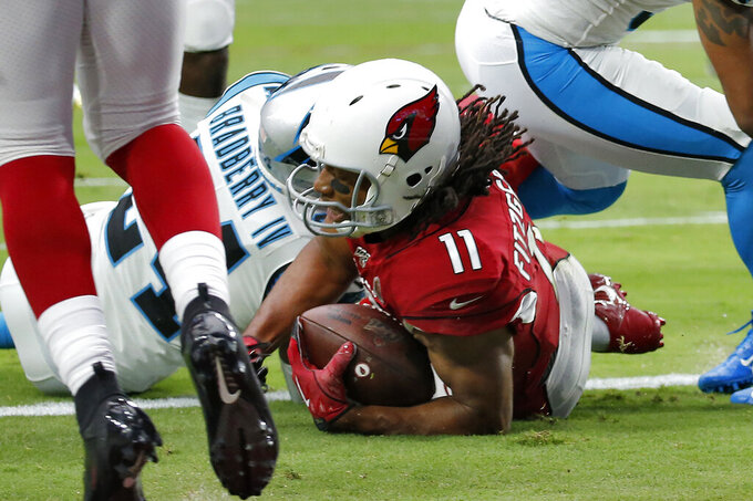 Arizona Cardinals wide receiver Larry Fitzgerald (11) scores a touchdown as Carolina Panthers cornerback James Bradberry defends during the first half of an NFL football game, Sunday, Sept. 22, 2019, in Glendale, Ariz. (AP Photo/Ross D. Franklin)