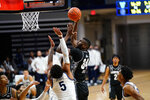 Georgetown's Qudus Wahab (34) goes up for a shot against Villanova's Justin Moore (5) during the second half of an NCAA college basketball game, Sunday, Feb. 7, 2021, in Villanova, Pa. (AP Photo/Matt Slocum)