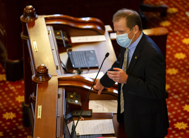 Illinois State Sen. Paul Schimpf, R-Waterloo, asks questions of Illinois State Sen. Julie Morrison, D-Deerfield, during debate on SB1863, a bill dealing with vote by mail and other changes for the 2020 election, on the floor of the Illinois Senate during session at the Illinois State Capitol, Friday, May 22, 2020, in Springfield, Ill. (Justin L. Fowler/The State Journal-Register via AP, Pool)
