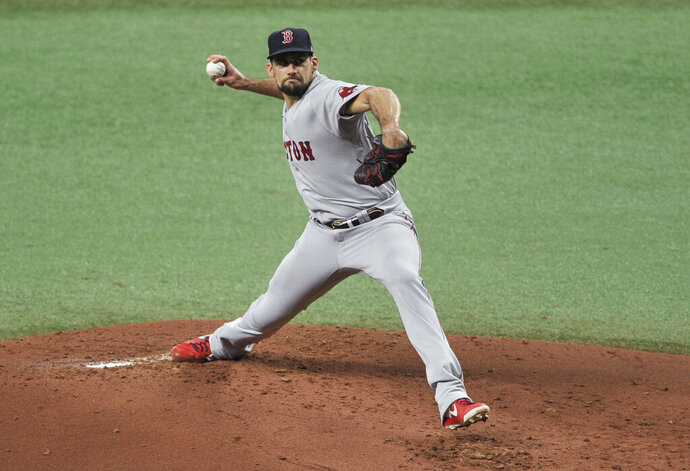 Boston Red Sox starter Nathan Eovaldi pitches to a Tampa Bay Rays batter during the first inning of a baseball game Saturday, Sept. 12, 2020, in St. Petersburg, Fla. (AP Photo/Steve Nesius)