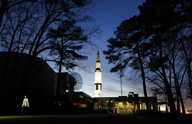 FILE - An employee leaves the state operated U.S. Space & Rocket Center, which serves as the visitor center for the nearby federally funded NASA Marshall Space Flight Center, in Huntsville, Ala. in this Tuesday, Jan. 8, 2019 file photo. Space Camp, an educational program attended by nearly 1 million people, said Tuesday July 28, 2020 it's in danger of closing without a cash infusion because of the coronavirus pandemic.(AP Photo/David Goldman, File)