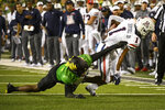 Oregon cornerback Mykael Wright (2) tackles Arizona running back Stanley Berryhill III (1) during the second quarter of an NCAA college football game Saturday, Sept. 25, 2021, in Eugene, Ore. (AP Photo/Andy Nelson)