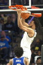 FILE  - In this Feb. 25, 2020, file photo, then-Wake Forest center Olivier Sarr dunks during the second half of the team's NCAA college basketball game against Duke, in Winston-Salem, N.C. The No. 10 Kentucky Wildcats lost five starters among nine departures from last season including coaches SEC player of the year selection Immanuel Quickley and All-SEC first teamer Nick Richards. Expectations of another national championship remain high thanks to a consensus No. 1 recruiting class along with three transfers including 7-foot senior Olivier Sarr. (AP Photo/Lynn Hey, File)