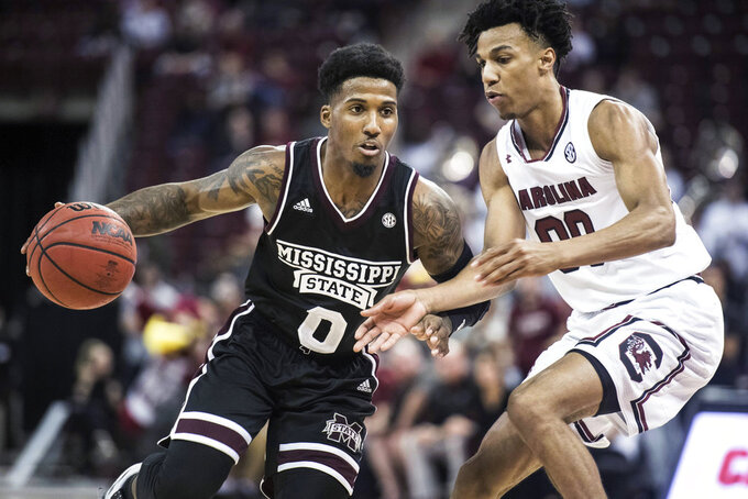 Mississippi State guard Nick Weatherspoon (0) is defended by South Carolina guard A.J. Lawson (00) during the first half of an NCAA college basketball game Tuesday, Jan. 8, 2019, in Columbia, S.C. (AP Photo/Sean Rayford)