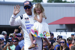 Dale Earnhardt Jr., holds his daughter Isla, 3, during driver introductions before the NASCAR Xfinity auto race in Richmond, Va., Saturday, Sept. 11, 2021. (AP Photo/Steve Helber)