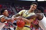 Georgia Tech guard Michael Devoe (0), center, fights Louisville guard Lamarr Kimble (0), right, and guard Darius Perry (2) for the ball during the first half of an NCAA college basketball game in Louisville, Ky., Wednesday, Jan. 22, 2020. (AP Photo/Timothy D. Easley)