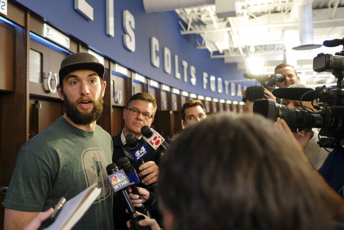 Indianapolis Colts quarterback Andrew Luck speaks to the media in the locker room at the NFL team's facility in Indianapolis, Sunday, Jan. 13, 2019. The team ended their season with a loss to Kansas City in a playoff game the day before. (AP Photo/AJ Mast)