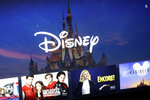 a Disney logo forms part of a menu for the Disney Plus movie and entertainment streaming service on a computer screen in Walpole, Mass., Wednesday, Nov. 13, 2019. Disney Plus says it hit more than 10 million sign-ups on its first day of launch, far exceeding expectations. (AP Photo/Steven Senne)
