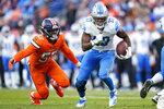 Detroit Lions running back Kerryon Johnson (33) runs as Denver Broncos outside linebacker Von Miller (58) pursues during the second half of an NFL football game, Sunday, Dec. 22, 2019, in Denver. (AP Photo/Jack Dempsey)