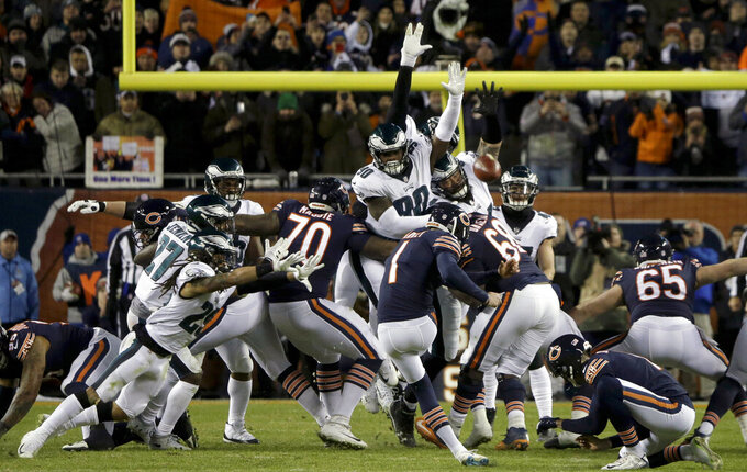 FILE- In this Jan. 6, 2019, file photo, Chicago Bears kicker Cody Parkey (1) boots a field goal-attempt during the second half of an NFL wild-card playoff football game against the Philadelphia Eagles in Chicago. Eagles' Treyvon Hester (90) tipped Parkey's attempt just enough to send the ball bouncing off the upright and crossbar, securing a 16-15 win at Chicago in the wild-card round. The Green Bay Packers have signed defensive lineman Treyvon Hester, who is set to play for his fourth different NFL team in as many seasons.(AP Photo/David Banks, File)