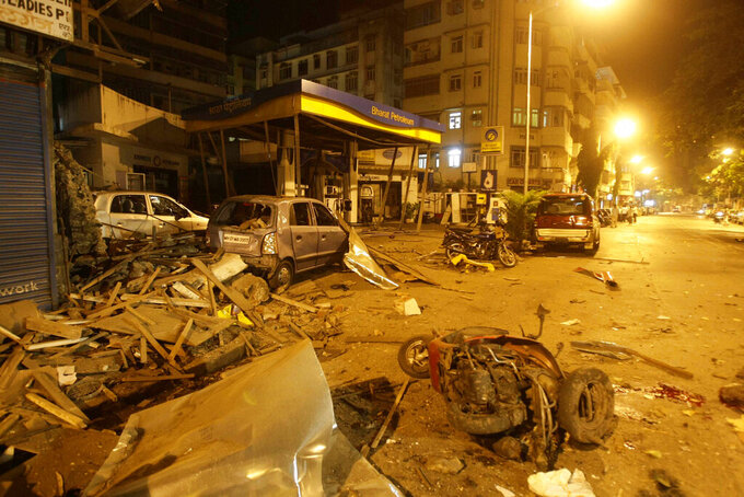FILE - In this Wednesday, Nov. 26, 2008 file photo, debris lies scattered in the street at the site of a blast in Coilaba, a market in downtown Mumbai, India, one of several attacks throughout the city. (AP Photo/Gautam Singh)