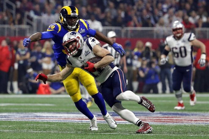 New England Patriots' Julian Edelman (11) runs the ball during the second half of the NFL Super Bowl 53 football game against the Los Angeles Rams, Sunday, Feb. 3, 2019, in Atlanta. (AP Photo/Jeff Roberson)