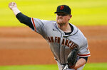San Francisco Giants starting pitcher Logan Webb throws to the plate against the Colorado Rockies during the first inning of a baseball game, Wednesday, Aug. 5, 2020, in Denver. (AP Photo/Jack Dempsey)