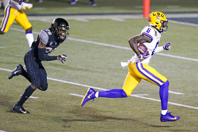 LSU wide receiver Terrace Marshall Jr. (6) beats Vanderbilt cornerback Allan George (28) for a touchdown on a 51-yard pass reception in the first half of an NCAA college football game Saturday, Oct. 3, 2020, in Nashville, Tenn. (AP Photo/Mark Humphrey)