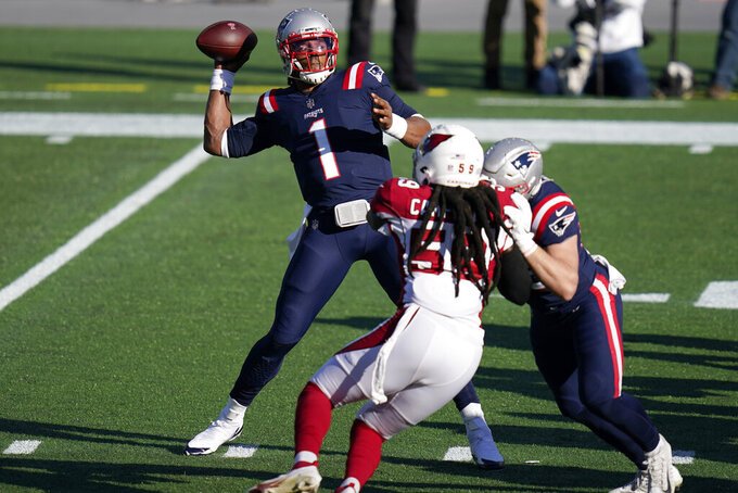 New England Patriots quarterback Cam Newton, left, passes under pressure from Arizona Cardinals linebacker De'Vondre Campbell (59) in the first half of an NFL football game, Sunday, Nov. 29, 2020, in Foxborough, Mass. (AP Photo/Charles Krupa)