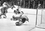 FILE - In this Dec. 19, 1973, file photo, Chicago Blackhawks goalie Tony Esposito (35) stops a Buffalo Sabres shot during the first period of an NHL hockey game in Chicago. Chicago's Phil Russell (5) watches as Buffalo's Jim Lorentz (8) keeps Chicago's Pit Martin (7) out of the play. Esposito, a Hall of Fame goaltender who played almost his entire 16-year career with the Blackhawks, has died following a brief battle with pancreatic cancer, the team announced Tuesday, Aug. 10, 2021. He was 78. (AP Photo/Fred Jewell. File)
