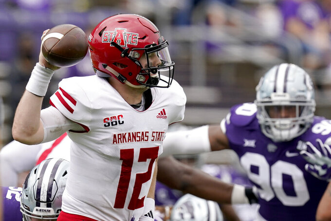 Arkansas State quarterback Logan Bonner throws during the second half of an NCAA college football game against Kansas State, Saturday, Sept. 12, 2020, in Manhattan, Kan. (AP Photo/Charlie Riedel)
