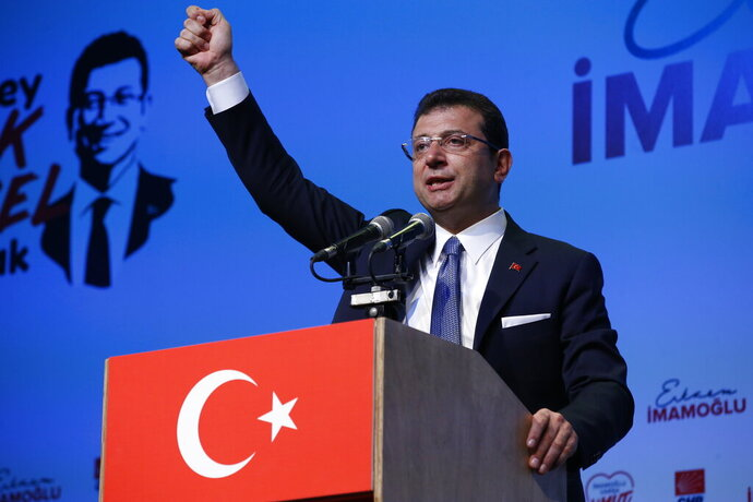 Ekrem Imamoglu, Turkey's secular opposition Republican People's Party's (CHP) mayoral candidate for Istanbul gestures as he delivers a speech at the launch of his campaign for the June 23 re-run elections, in Istanbul, Wednesday, May 22, 2019. Imamoglu, promising he would win back the seat after Turkey's electoral board ruled to void the local polls earlier this month, is running a positive messaging campaign under the motto