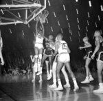 FILE - In this March 23, 1963, file photo, Loyola's Vic Rouse (40) leaps to score the most important points in the National Collegiate basketball finals in Louisville, Ky. This shot, at the very end of overtime period, put the Chicago team in the championship spot with a 60-58 win over defending champion Cincinnati. Loyola Chicago guard Lucas Williamson is lending his voice and perspective to an upcoming documentary. The film is about the Ramblers' barrier-breaking team that won the 1963 NCAA championship. (AP Photo/File)