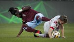 Colorado Rapids defender Lalas Abubakar, left, tangles with Toronto FC forward Patrick Mullins (13) for the ball in the first half of an MLS soccer game in Denver, Saturday, Sept. 25, 2021. (AP Photo/Joe Mahoney)